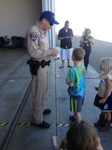 CHP Officer Handing Out Stickers To The Students