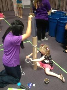 Pretend City's Friendly Staff Helping Field Trip Girl Build A Roller Coaster